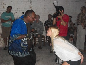 The Creole Zydeco Farmer's washboard player dances with a fan